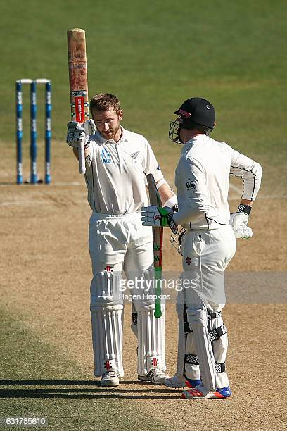 Kane Williamson of New Zealand celebrates his century with teammate Henry Nicholls during day five of the First Test match between New Zealand and...