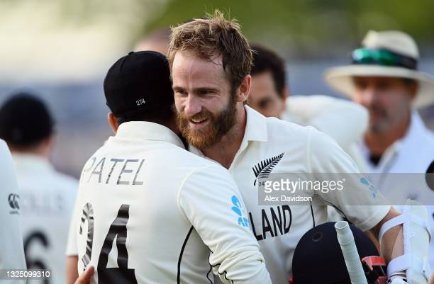 Kane Williamson of New Zealand celebrates with Ajaz Patel after the Reserve Day of the ICC World Test Championship Final between India and New...