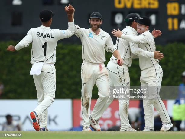 Kane Williamson of New Zealand celebrates with his team mates after takes last wicket of Sri Lankan batsman Lasith Embuldeniya as won the Second Test...