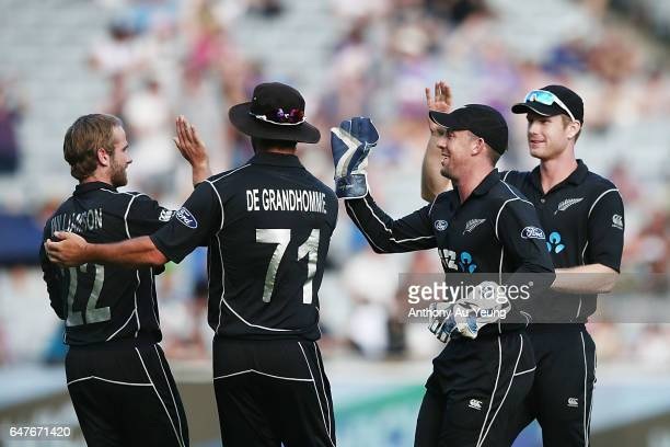 Kane Williamson of New Zealand celebrates with teammates after dismissing Quinton de Kock of South Africa during game five of the One Day...