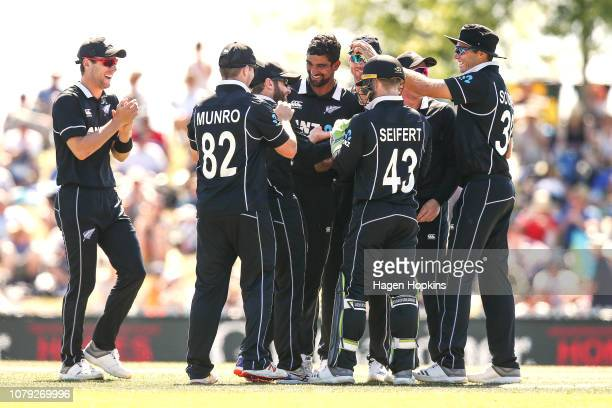 Kane Williamson of New Zealand celebrates with teammates after taking the wicket of Kamindu Mendi of Sri Lanka during game three of the One Day...