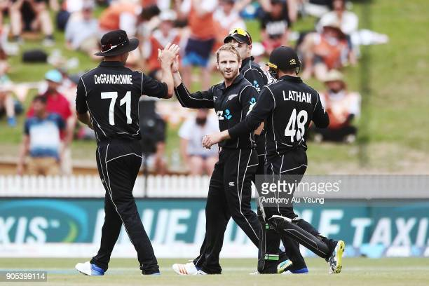 Kane Williamson of New Zealand celebrates with teammates for the wicket of Shoaib Malik of Pakistan during game four of the One Day International...