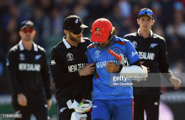 Kane Williamson of New Zealand checks Rashid Kahn of Afghanistan after being struck on the head and being dismissed during the Group Stage match of...