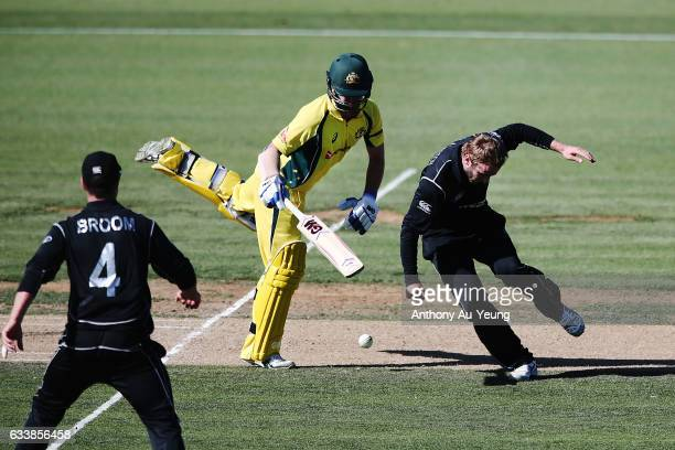 Kane Williamson of New Zealand clashes with Travis Head of Australia during game three of the One Day International series between New Zealand and...