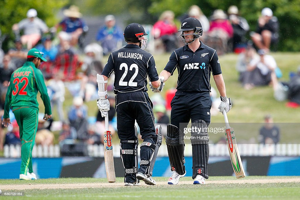 Kane Williamson of New Zealand congratulates team mate Neil Broom of after reaching a half century during the third One Day International match between New Zealand and Bangladesh at Saxton Field on December 31, 2016 in Nelson, New Zealand.