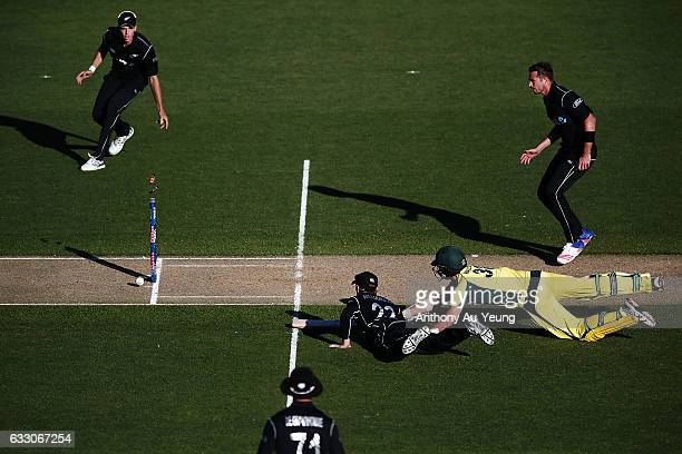Kane Williamson of New Zealand dismisses Josh Hazlewood of Australia on a run out to win the first One Day International game between New Zealand and...