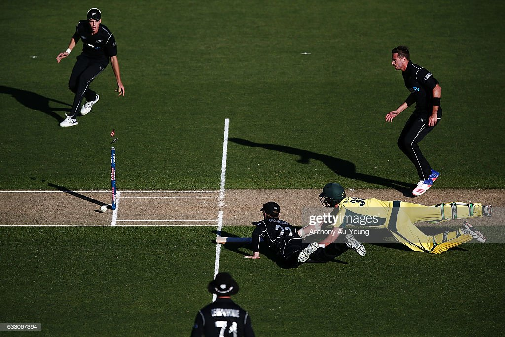 Kane Williamson of New Zealand dismisses Josh Hazlewood of Australia on a run out to win the first One Day International game between New Zealand and Australia at Eden Park on January 30, 2017 in Auckland, New Zealand.