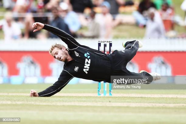 Kane Williamson of New Zealand dives to make his own catch during game four of the One Day International Series between New Zealand and Pakistan at...