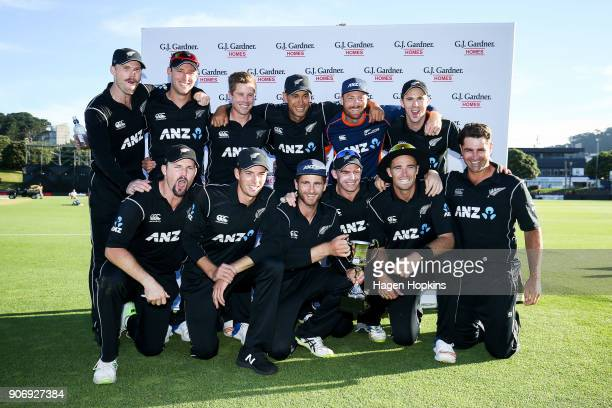 Kane Williamson of New Zealand hold the series trophy after winning game five of the One Day International Series between New Zealand and Pakistan at...