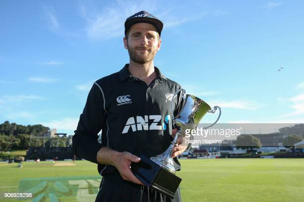 Kane Williamson of New Zealand holds the series trophy after winning game five of the One Day International Series between New Zealand and Pakistan...