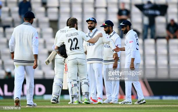 Kane Williamson of New Zealand interacts with Virat Kohli of India after victory in the Reserve Day of the ICC World Test Championship Final between...