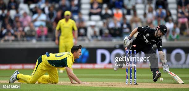 Kane Williamson of New Zealand is run out by Pat Cummins of Australia during the ICC Champions Trophy match between Australia and New Zealand at...