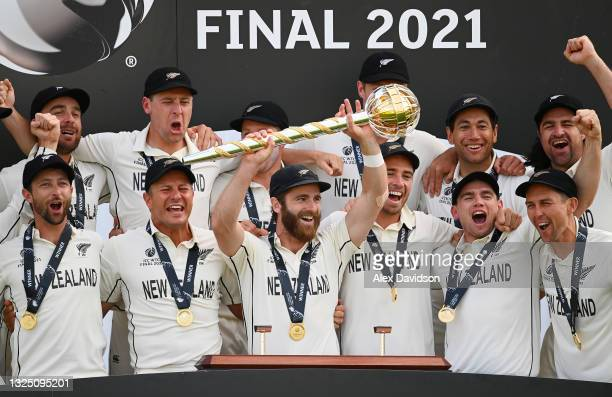 Kane Williamson of New Zealand lifts the ICC World Test Championship Mace with teammates after victory in the Reserve Day of the ICC World Test...