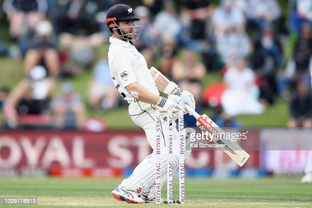 Kane Williamson of New Zealand looks dejected after being dismissed by Jasprit Bumrah of India during day three of the Second Test match between New...