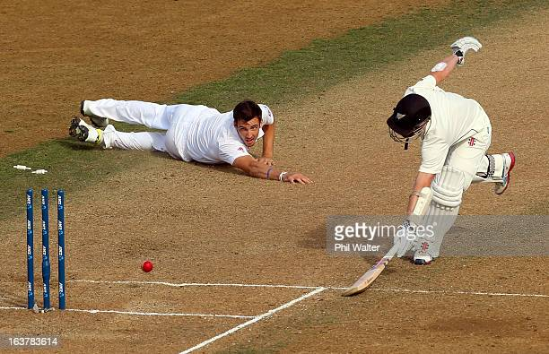 Kane Williamson of New Zealand makes his crease as England bowler Steven Finn looks on during day three of the second Test match between New Zealand...