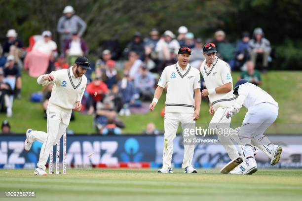 Kane Williamson of New Zealand, Neil Wagner of New Zealand and Tim Southee of New Zealand look on as Jasprit Bumrah of India is run out during day...
