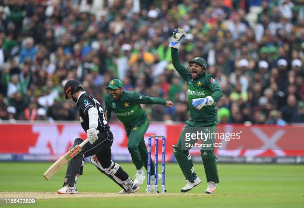 Kane WIlliamson of New Zealand plays a shot and is caught behind by Sarfaraz Ahmed of Pakistan during the Group Stage match of the ICC Cricket World...