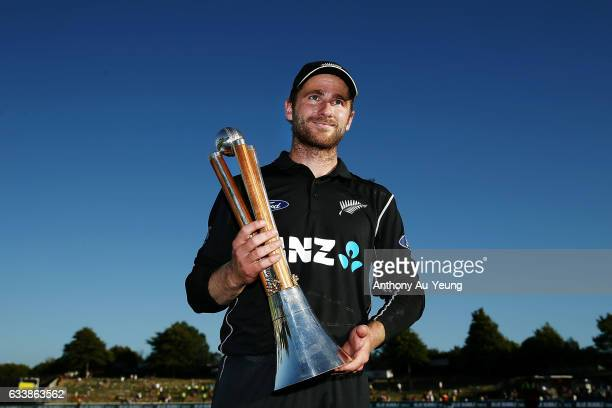 Kane Williamson of New Zealand poses with the ChappellHadlee Trophy after winning game three of the One Day International series between New Zealand...