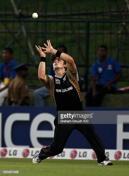 Kane Williamson of New Zealand takes an outfield catch to dismiss Mushfiqur Rahim of Bangladesh during the ICC World T20 Group D match between New...