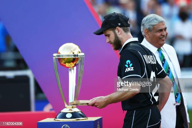 Kane Williamson of New Zealand walks past the World Cup trophy after defeat during the Final of the ICC Cricket World Cup 2019 between New Zealand...