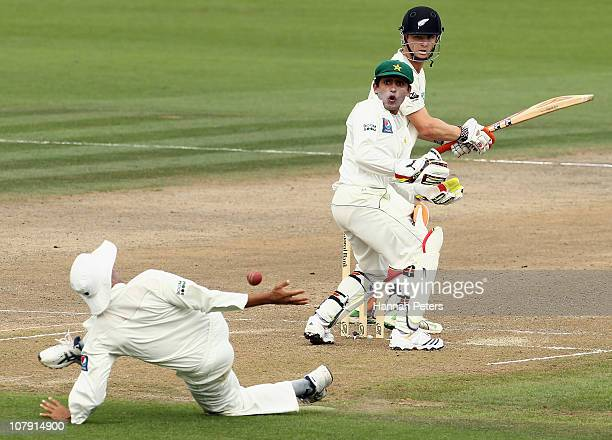 Kane Williamson of the Black Caps looks on as Younis Khan of Pakistan drops a catch during day one of the First Test match between New Zealand and...