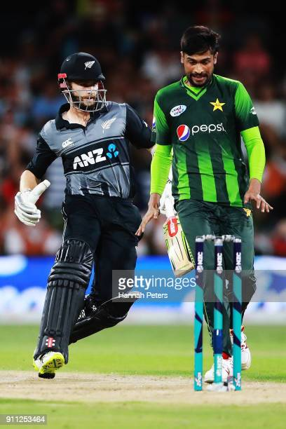 Kane Williamson of the Black Caps runs in to Mohammad Amir of Pakistan during game three of the International Twenty20 match between New Zealand and...