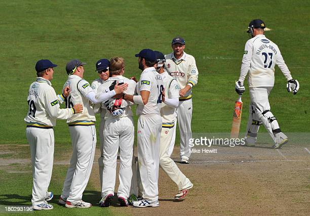 Kane Williamson of Yorkshire is mobbed by team mates after bowling Rory Hamilton-Brown of Sussex during the LV County Championship match between...