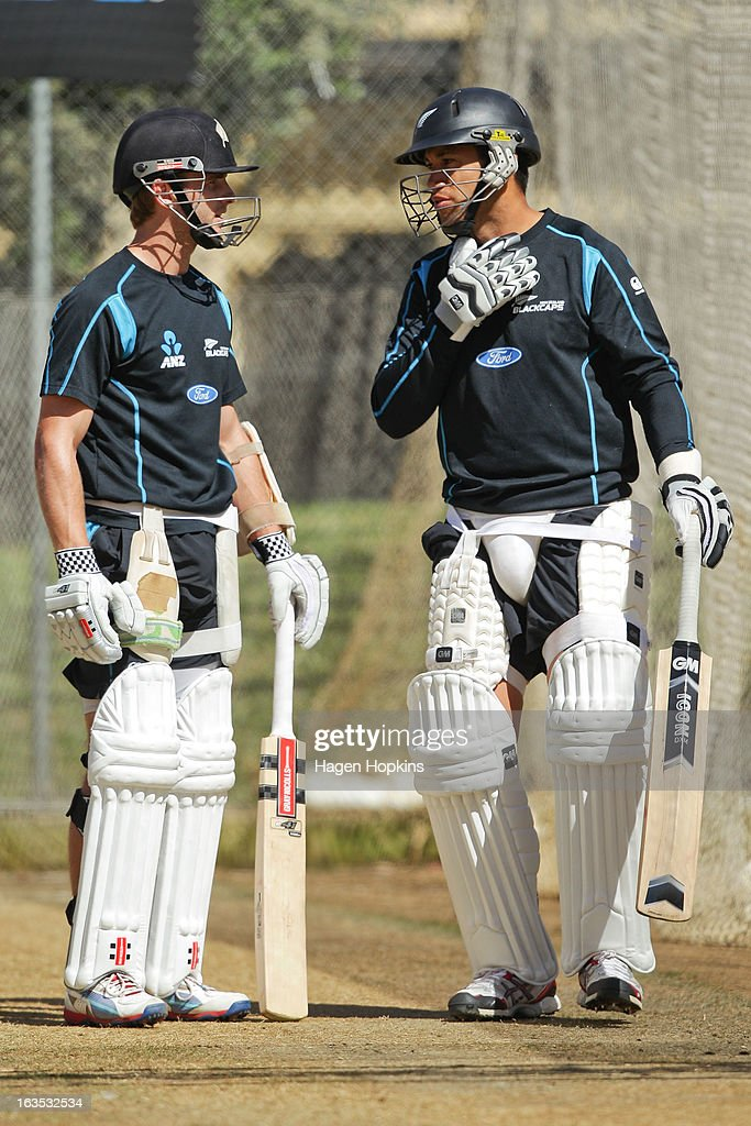 Kane Williamson (L) speaks to teammate Ross Taylor during a New Zealand training session at Basin Reserve on March 12, 2013 in Wellington, New Zealand.