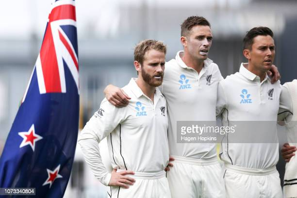 Kane Williamson Tim Southee and Trent Boult of New Zealand sing the national anthem during day one of the First Test match in the series between New...