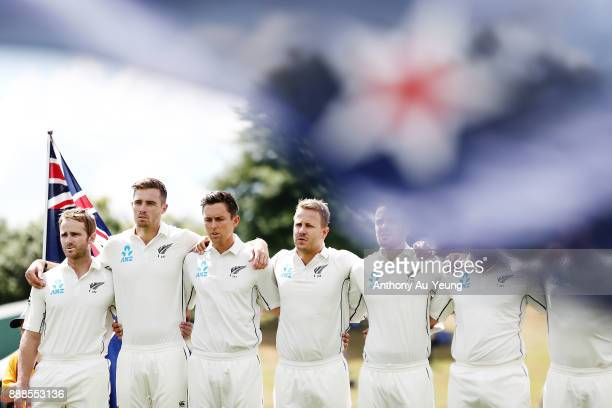 Kane Williamson Tim Southee Trent Boult and Neil Wagner of New Zealand stand for the national anthem during day one of the second Test match between...