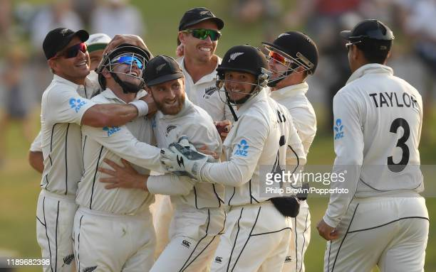 Kane Williamson, Tom Latham, Neil Wagner, Tim Southee and BJ Watling of New Zealand celebrate after Latham caught Jack Leach of England during day...