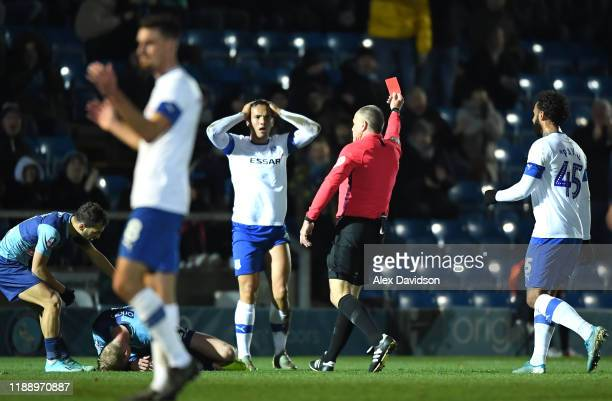 Kane Wilson of Tranmere Rovers is given a red card by referee Graham Salisbury during the FA Cup First Round Replay between Wycombe Wanderers and...