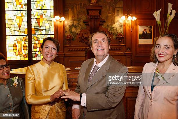 Kanee Danevong Francois Florent and Dominique Blanc attend the Wedding of Francois Florent And Kanee Danevong at Mairie Du XVIII on September 12 2014...