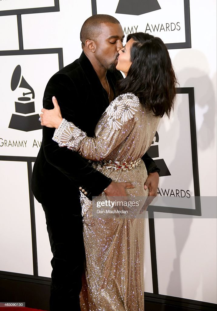 {Kaneye West and Kim Kardashian (R) (R) attend The 57th Annual GRAMMY Awards at the STAPLES Center on February 8, 2015 in Los Angeles, California.