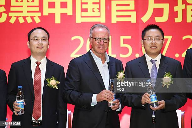 Kang Bing Chairman of Guangzhou Evergrande Taobao Football Club KarlHeinz Rummnigge CEO of FC Bayern Munchen and Liu Yongzhuo vice president of...