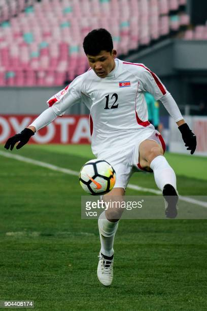 Kang II KukChol of North Korea kicks the ball during the AFC U23 Championship Group B match between Palestine and North Korea at Jiangyin Stadium on...
