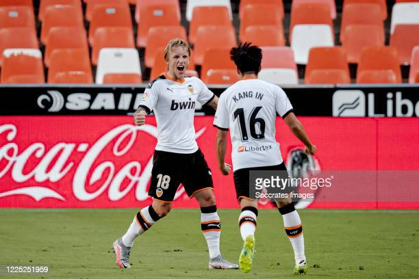 Kang In Lee of Valencia celebrates 2-1 with Daniel Wass of Valencia during the La Liga Santander match between Valencia v Real Valladolid at the...