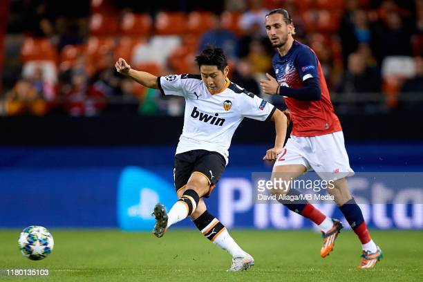 Kang In Lee of Valencia CF competes for the ball with Yusuf Yazici of Lille OSC during the UEFA Champions League group H match between Valencia CF...