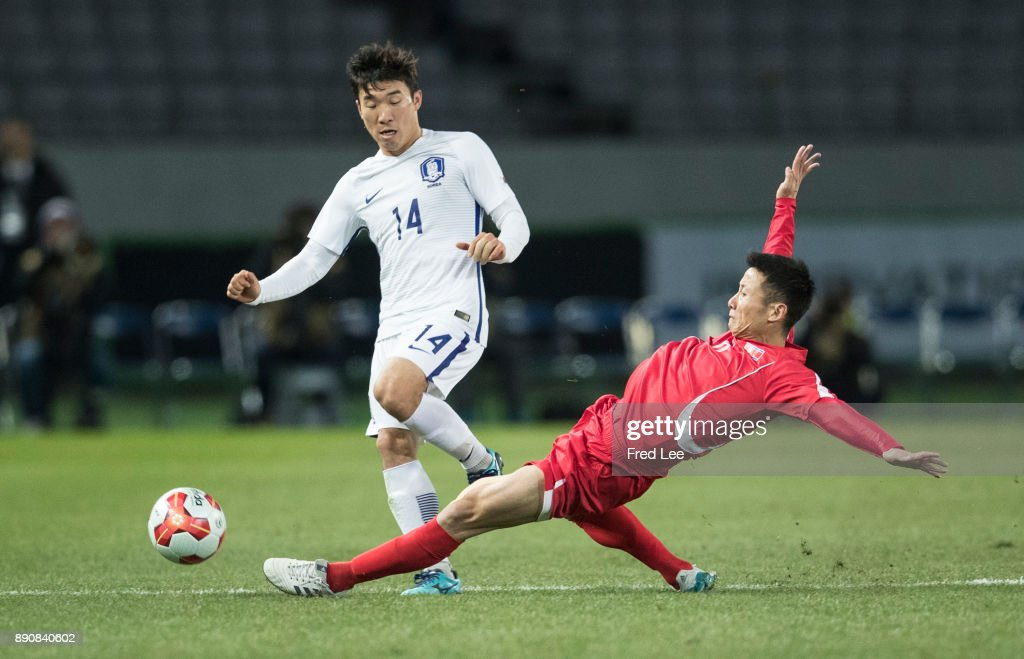 Kang Kuk Chol #6 of DPR Korea and Go yohan #14 of South Korea in action during the EAFF E-1 Men's Football Championship between North Korea and South Korea at Ajinomoto Stadium on December 12, 2017 in Chofu, Tokyo, Japan.