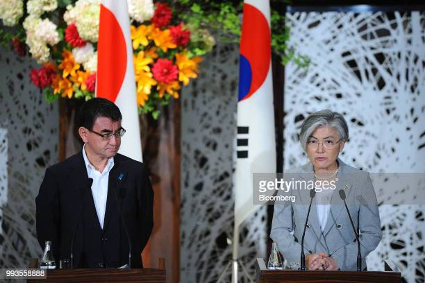 Kang KyungWha South Korea's foreign minister right speaks during a news conference with Taro Kono Japan's foreign minister left and Mike Pompeo US...