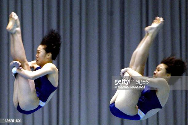 Kang MinKyung and Im SunYoung of South Korea perform a somersault during the women's three meters sychronized diving final at Sajik pool in Busan 08...