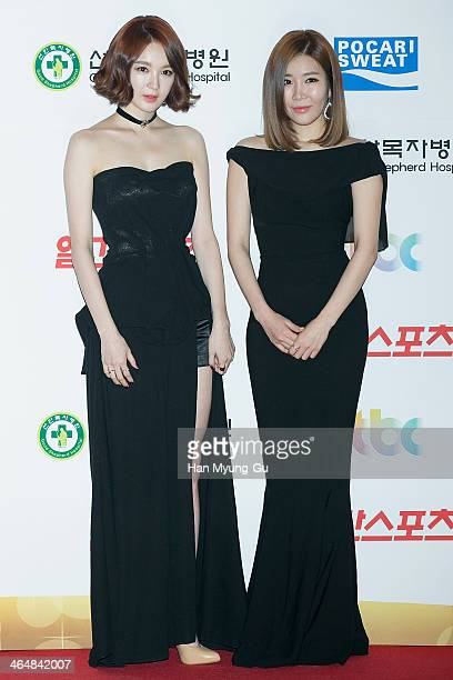 Kang MinKyung and Lee HaeRi of South Korean girl group Davichi attend the 28th Golden Disk Awards at Kyunghee University on January 16 2014 in Seoul...