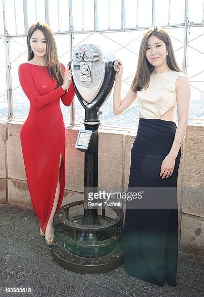 Kang MinKyung and Lee HaeRi of the Kpop group Davichi attend the lighting of The Empire State building on October 23 2015 in New York City