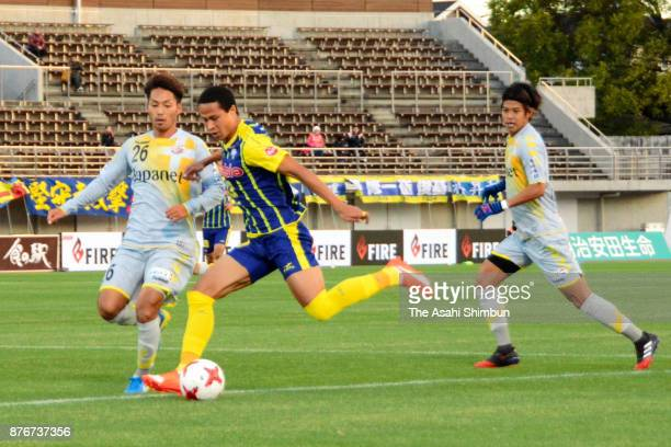 Kang Soo Il of Thespa Kusatsu and Teppei Usui of VVaren Nagasaki compete for the ball during the JLeague J2 match between Thespa Kusatsu Gunma and...