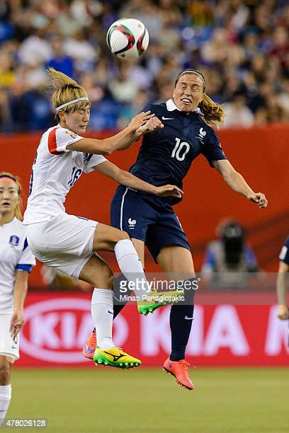 Kang Yumi of Korea Republic and Camille Abily of France jump for the ball during the 2015 FIFA Women's World Cup Round of 16 match at Olympic Stadium...