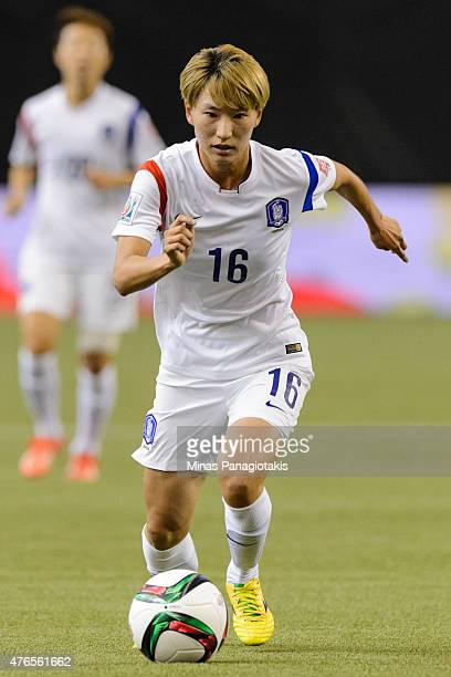 Kang Yumi of Korea Republic moves the ball during the 2015 FIFA Women's World Cup Group E match against Brazil at Olympic Stadium on June 9 2015 in...