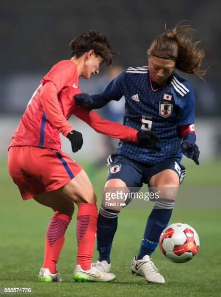 Kang Yumi of South Korea and Utsugi Rumi of Japan in action during the EAFF E1 Women's Football Championship between Japan and South Korea at Fukuda...