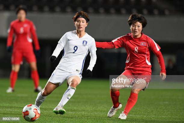 Kang Yumi of South Korea and Yu Jong Im of North Korea compete for the ball during the EAFF E1 Women's Football Championship between North Korea and...