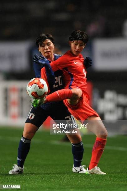 Kang Yumi of South Korea controls the ball under pressure of Miho Manya of Japan during the EAFF E1 Women's Football Championship between Japan and...