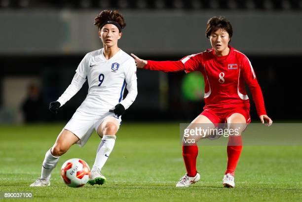 Kang Yumi of South Korea drives the ball during the EAFF E1 Women's Football Championship between North Korea and South Korea at Fukuda Denshi Arena...